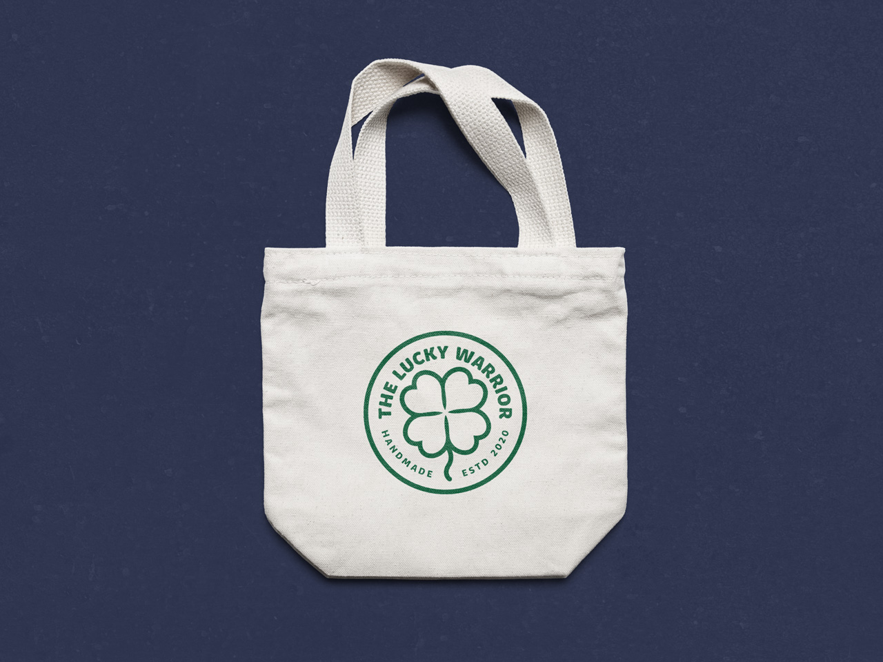 project the lucky warrior logo on tote